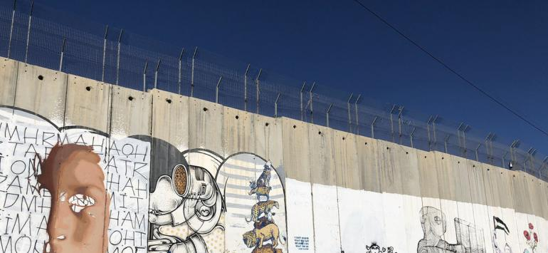 UN News/Reem Abaza Bethlehem: part of the barrier between Israel and the West Bank.